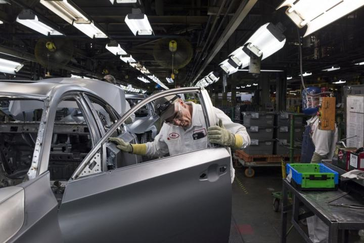 An employee inspects a door at the Honda auto plant in Marysville, OH.