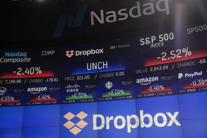 Dropbox's logo is displayed during the company's initial public offering at the Nasdaq MarketSite in New York City.