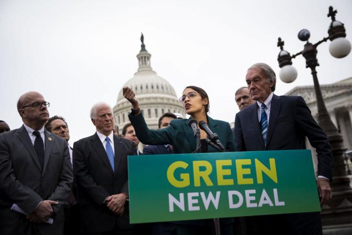 Rep. Alexandria Ocasio-Cortez (D-NY) and Sen. Ed Markey (D-MA) speak at a news conference announcing Green New Deal legislation in Washington, D.C.