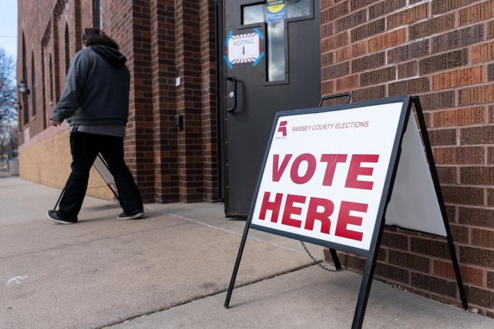 """""""Vote Here"""" sign outside a Ramsey County, MN voting precinct."""