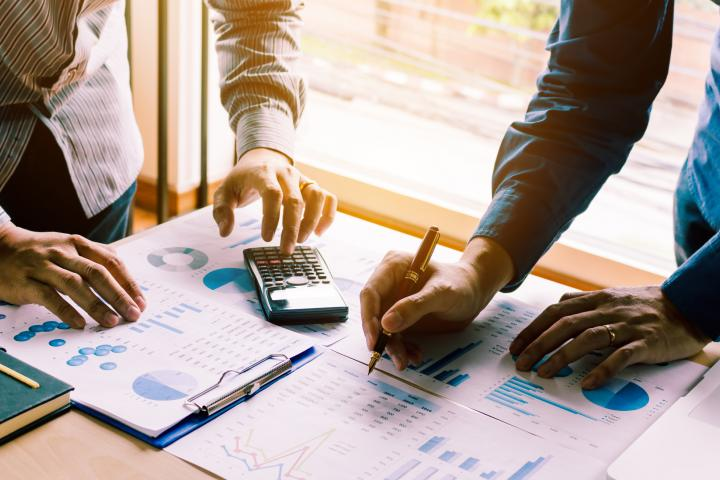 Corporate employees look at financial projections.