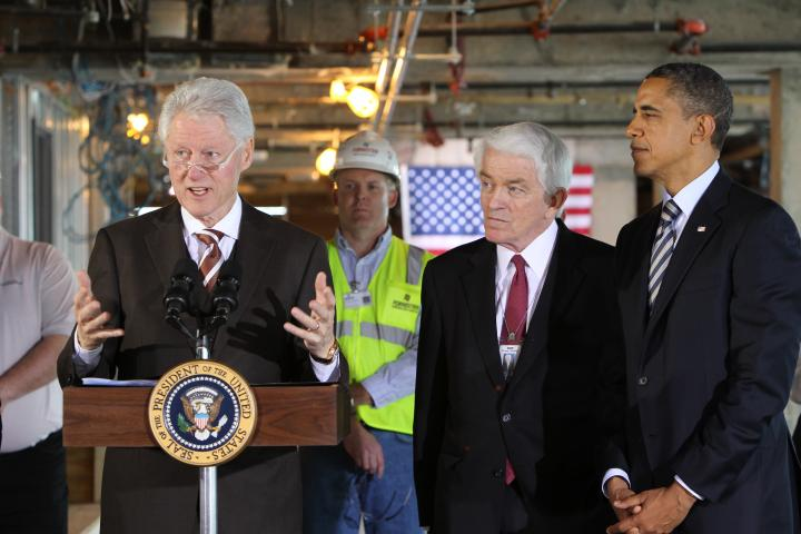 Former President Bill Clinton talking to the media in Washington, D.C., with President Barack Obama and U.S. Chamber President and CEO Tom Donohue in December 2011