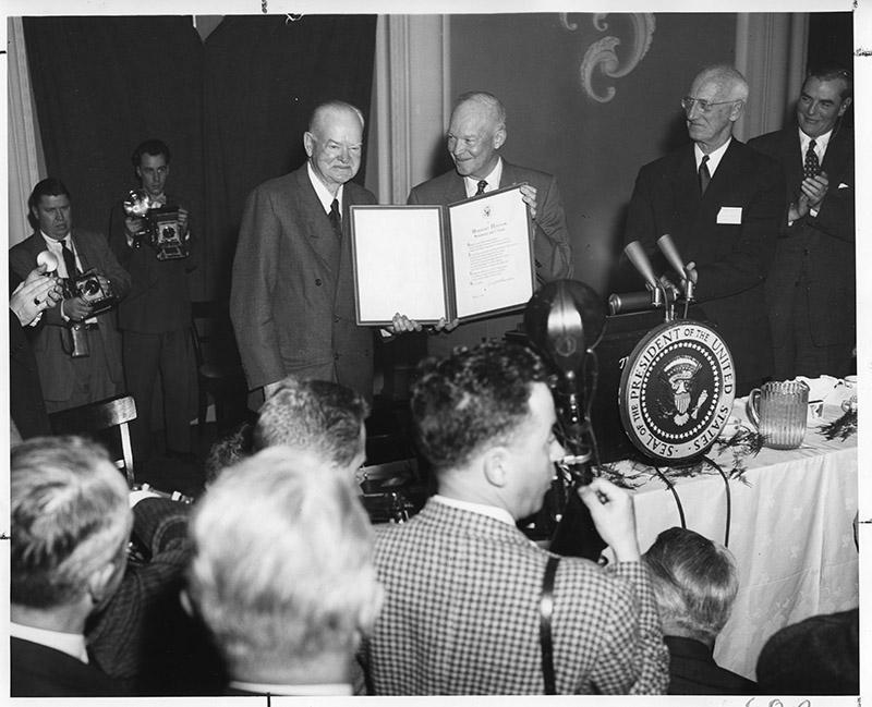 President Hoover is honored with a scroll presented by President Eisenhower in recognition of the former Chief Executive's devoted lifetime of work for his government on Feb. 8, 1957.