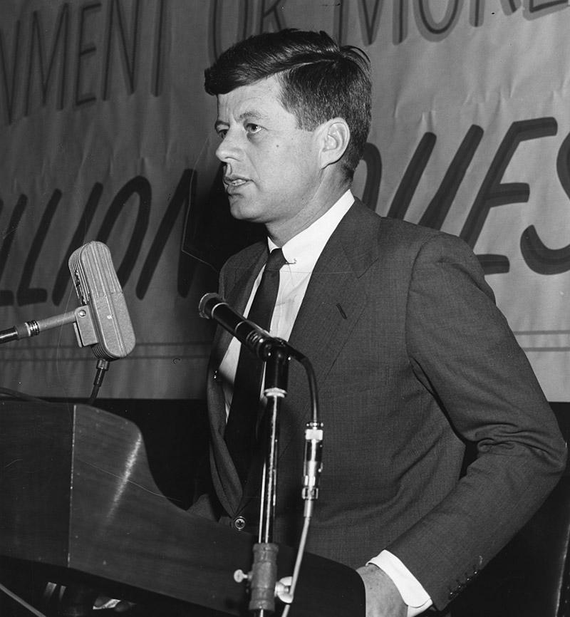 President John F. Kennedy speaking at National Conference on Hoover Report on March 23, 1956.