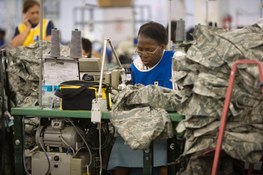 Goodwill participant in Miami making U.S. Army uniforms.
