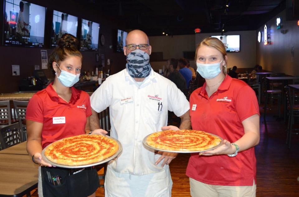 Photo via Grotto Pizza Website