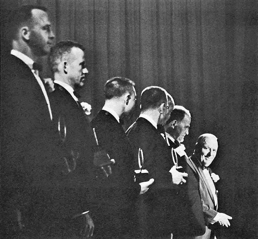 "The seven original American astronauts, Gordon Cooper, John Glenn, Gus Grissom, Alan Shepard, Scott Carpenter, Wally Schirra, and Deke Slayton, receive the ""Great Living American Award"" at the U.S. Chamber in 1962."