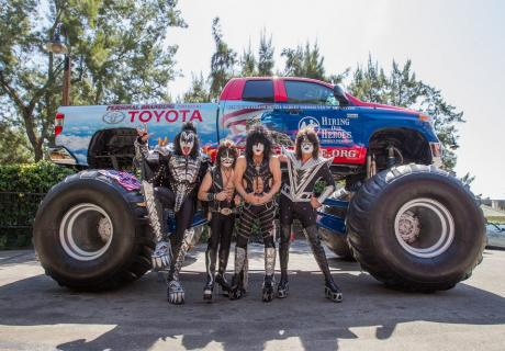 KISS standing in front of a Hiring our Heroes monster truck