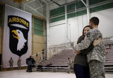 U.S. Army Capt. Gareth Scott holds his wife Kelly Scott after reuniting during a homecoming ceremony at Fort Campbell, Kentucky. Photographer: Luke Sharrett/Bloomberg