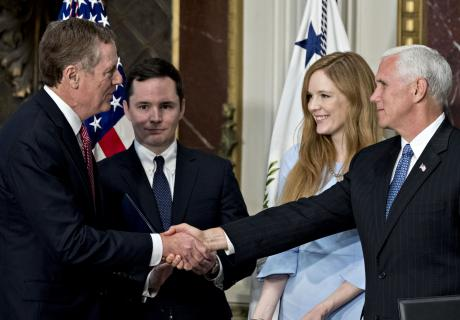 Robert Lighthizer, U.S. trade representative shakes hands with U.S. Vice President Mike Pence after being sworn in. Photographer: Andrew Harrer/Bloomberg