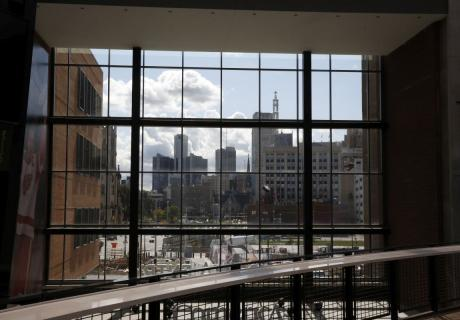 The Detroit skyline seen from the concourse of the Little Caesars Arena in Detroit, MI.