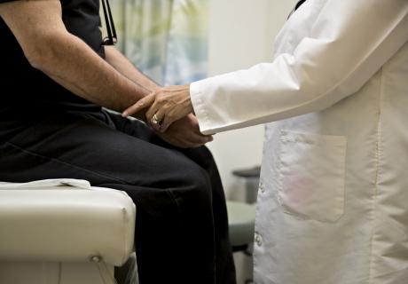 A doctor examines a patient at a clinic in Gaithersburg, Md.