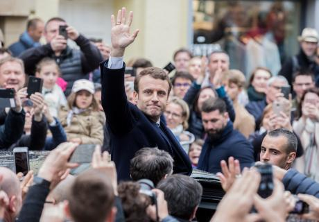 Emmanuel Macron waves to the crowd in Le Touquet, France.