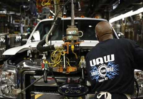 A worker assembles a Ford Super Duty series pickup truck at the company's manufacturing plant in Louisville, KY.