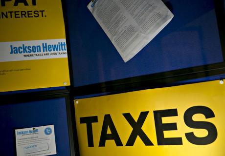 """A """"Taxes"""" sign is displayed at a Jackson Hewitt Tax office in Washington, D.C."""