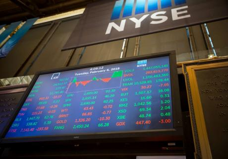 A monitor displays stock market information on the floor of the New York Stock Exchange (NYSE) in New York.