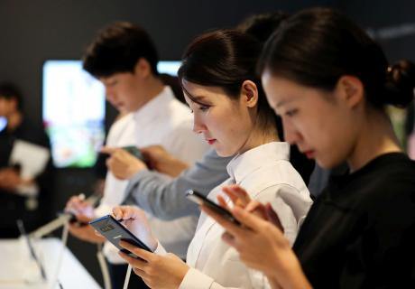 Attendees try out Samsung's Galaxy Note 8 smartphones at a media event in Seoul, South Korea.