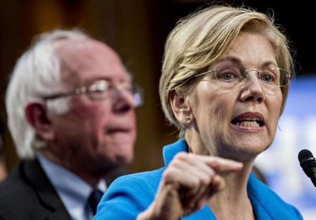 Sen. Elizabeth Warren (D-MA) speaks as Sen. Bernie Sanders (I-VT) listens at news conference in Washington, D.C.