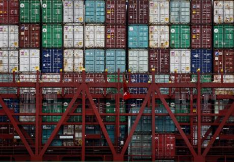 Shipping containers stacked on a ship as it is unloaded at the Port of Los Angeles.