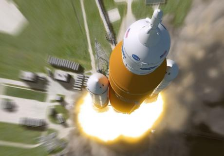 An artist's rendering shows the liftoff of the lift capacity configuration Space Launch System from the launchpad.