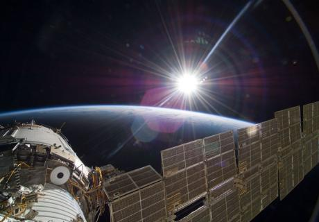 The bright sun greets the International Space Station.