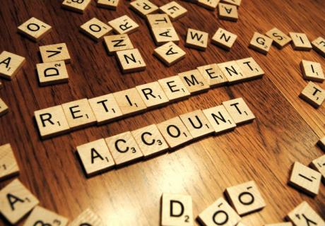 """""""Retirement account"""" spelled out in Scrabble tiles."""