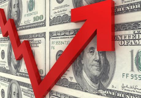 U.S. $100 bills with a red arrow going up depicting inflation