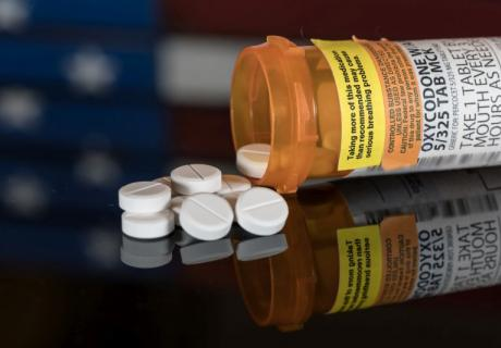 Pills and pill bottle of oxycodone.