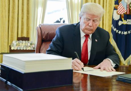 President Donald Trump signs the Tax Cuts and Jobs Act of 2017.