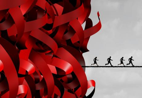 Illustration of people running away from a red tape avalanche.