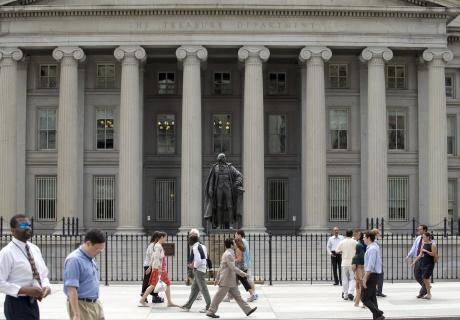 Pedestrians walk past the U.S. Treasury building in Washington, D.C. Photographer: Mannie Garcia/Bloomberg News