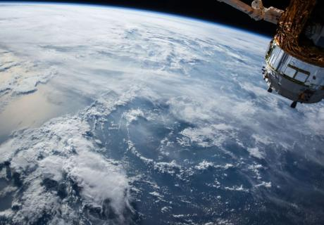 NASA satellite floating over the earth.