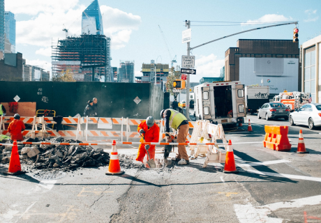 Workers repairing a road in New York City.
