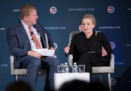 Myron Brilliant, executive vice president and head of International Affairs at the U.S. Chamber of Commerce (left), talks with Secretary Madeleine Albright at the Mandela Centennial Business Forum.