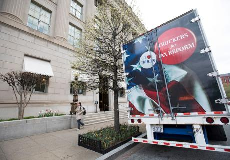 A semi tractor trailer celebrating tax cuts from the American Trucking Associations parked outside the U.S. Chamber.