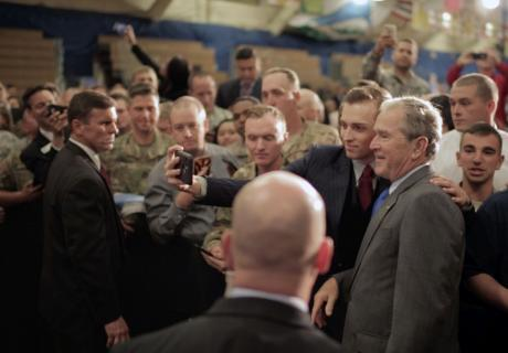 President George W. Bush has his photo taken at a veterans transition event in Fort Carson, Colorado.