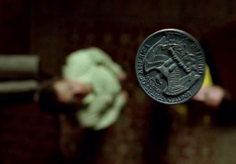 A U.S. quarter flipped in the air.