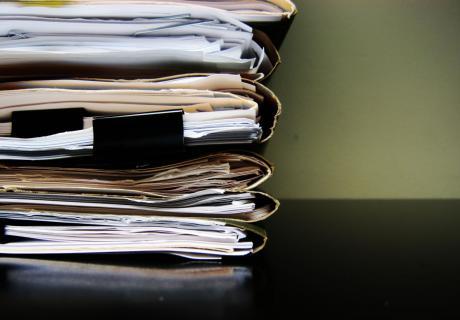 Stack of paperwork.