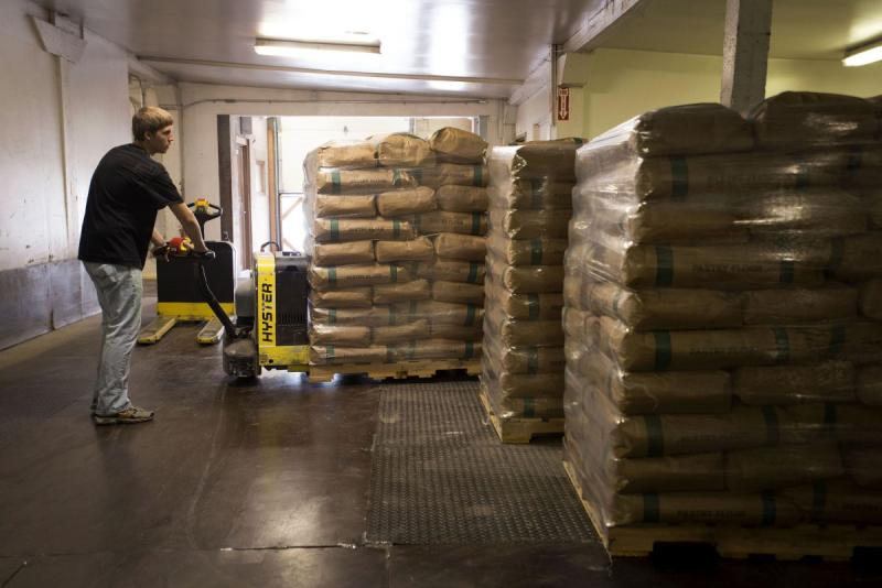 An employee moves bags of flour in the warehouse of a Brighton Mills facility in Cincinnati, OH.