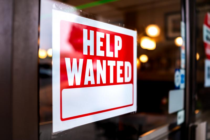 """""""Help Wanted"""" sign in window storefront"""