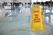 "Wet floor sign reads: ""Caution: Vague joint employer standard"""
