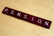 """""""Pension"""" made up of Scrabble tiles."""