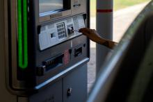 A customer uses a drive-thru ATM at a Bank of America branch in San Antonio, TX.