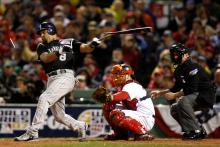 Yorvit Torrealba of the Colorado Rockies breaks his bat while batting.