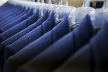 Blazers hang in a clothing factory in New York City.