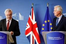 The U.K.'s David Davis (left) and the E.U.'s Michel Barnier speak at a Brexit negotiation press conference in Brussels, Belgium.