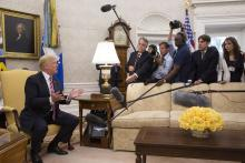 President Donald Trump speaks to the media in the Oval Office.
