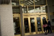 People entering the Federal Communications Commission headquarters in Washington, D.C.