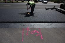 A worker helps pave a highway in Streator, IL.