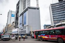 A city bus drives past office buildings in Lagos, Nigeria.